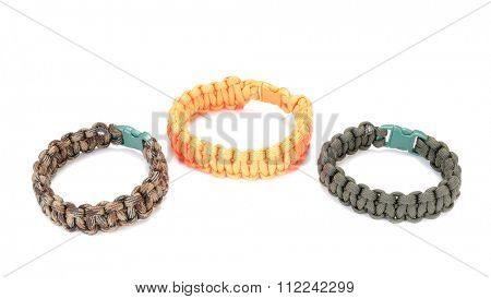 trio of cobra weave Parachute cord bracelets in a cobra weave on a white background