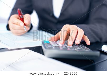 Hands of accountant business woman working with calculator.