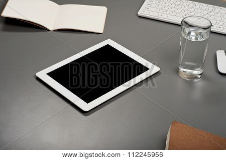 White Tablet Computer On A Gray Surface
