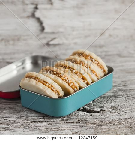 Shortbread Cookies With Caramel Cream And Walnuts In Vintage Metal Box  On A Light Wooden Board. Rus