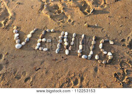 Venus inscription is lined stones on the beach