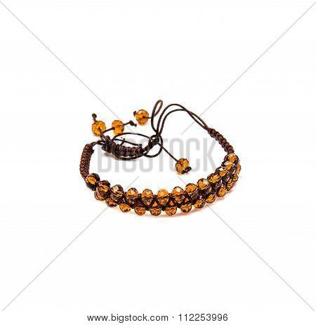 Bracelet With Orange Beads On White Background