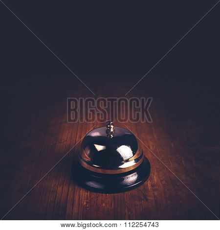 Hotel Service Call Bell On Wooden Reception Front Desk