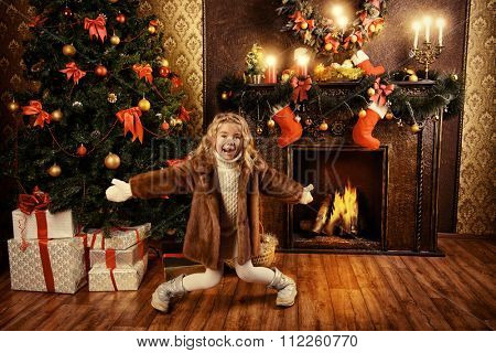 Cute little girl enjoys Christmas and New Year. Home decoration. The magic of Christmas.