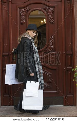 Woman Coming Back Home After Winter Sale