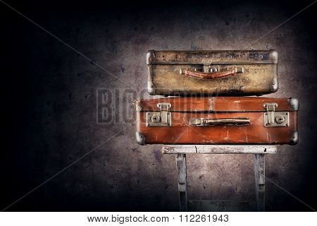 Vintage suitcases on chair