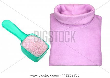 A pink heat retaining extra warm folded turtleneck t shirt with a spoon of washing Powder,  isolated on white background