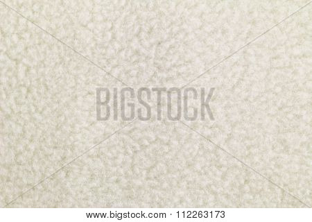Closeup background photo of texture of Off white heat retaining fleece textile