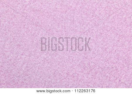 Closeup background photo of texture of pink heat retaining fleece textile