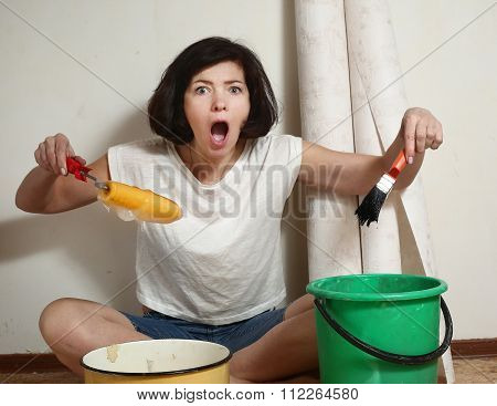 Happy Woman Prepares To Make A Repair