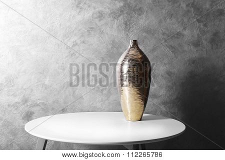 Vase on table in the room