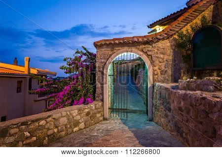 Old style stone gate at midnight