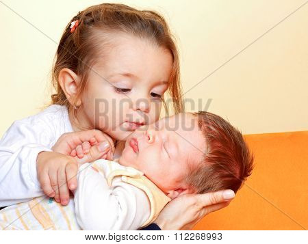 Girl With His Newborn Brother