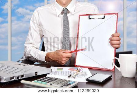 Businessman Holaing Blank Clipboard