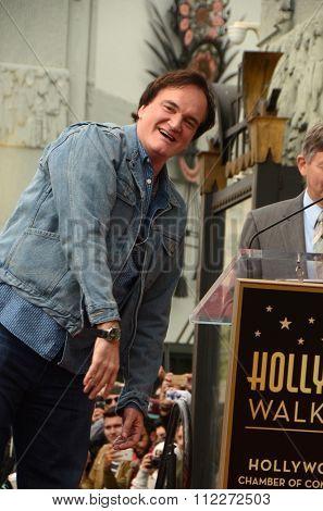 LOS ANGELES - DEC 21:  Quentin Tarantino at the Quentin Tarantino Hollywood Walk of Fame Star Ceremony at the Hollywood Blvd on December 21, 2015 in Los Angeles, CA