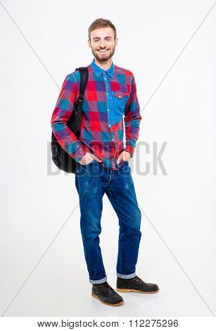 Full length portrait of a happy male student standing with backpack isolated on a white background