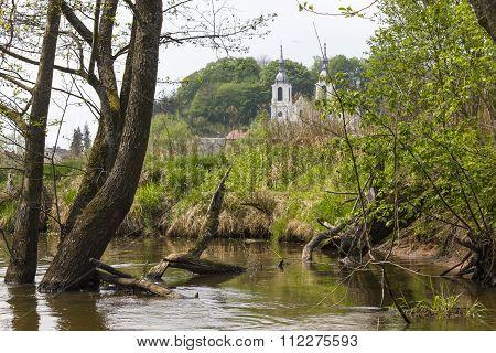 Church in the Baltow seen from the river Kamienna, Poland