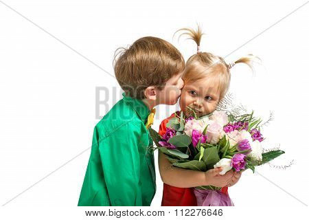Little boy and girl with flowers