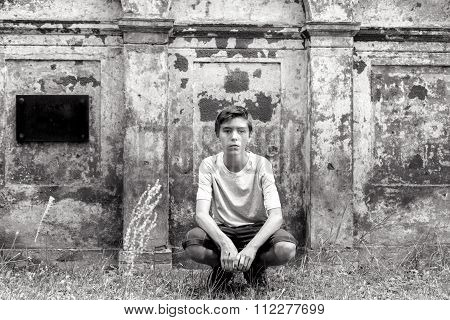 Portrait Of A Crouching Teenage Boy
