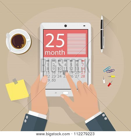Hands with tablet pc calendar application