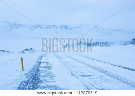 A road during a snowstorm through the lava field, Snaefellsnes Peninsula,  Iceland.