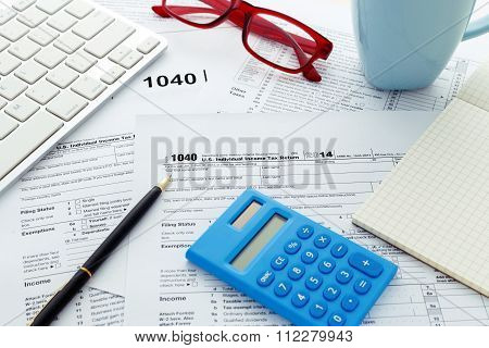 Tax Return Form With Pen And Calculator