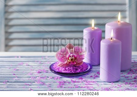 Spa salt with flower and candles on table