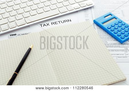 Tax Concept With Pen And Notebook