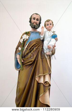 LIPIK, CROATIA - MAY 07: Saint Joseph holding baby Jesus, statue in the Church of Saint Francis of Assisi in Lipik, Croatia on May 07, 2015