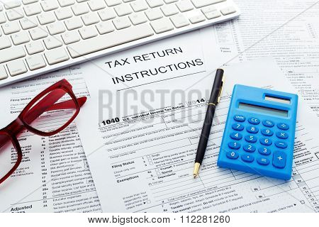 Tax Concept With Calculator And Computer Keyboard