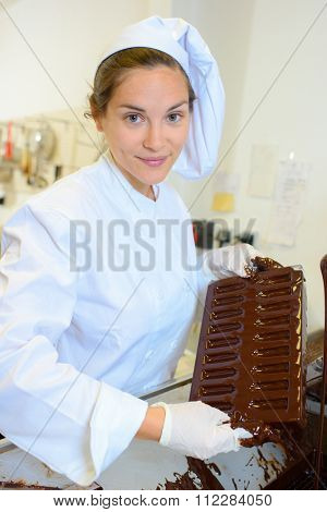 Chef holding moulded chocolate