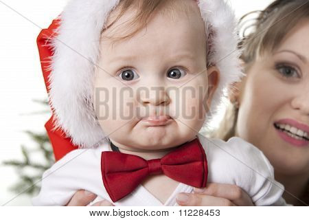 Close-up Sweet Baby In Santa's Hat