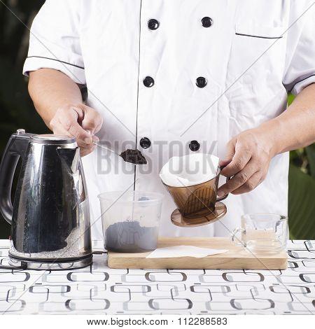 Chef Putting Grind Cofffe