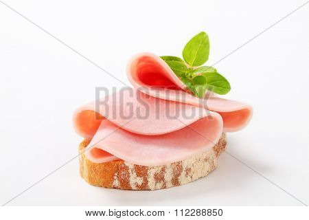 Slice of continental bread with ham