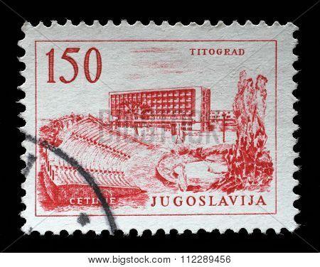 YUGOSLAVIA - CIRCA 1958: A stamp printed in Yugoslavia, shows Titograd (Podgorica) Hotel and Open-Air Theater in Cetinje, circa 1958