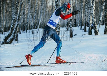 closeup male athlete skier during race forest classic style