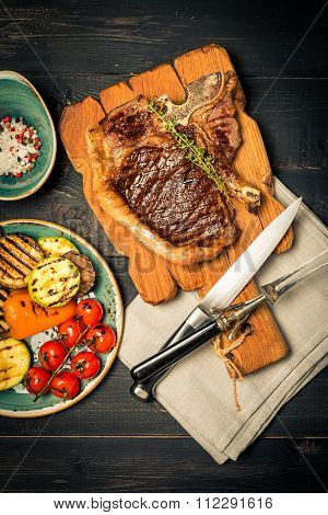 Club Beef Steak With Seasonings And Grilled Vegetables