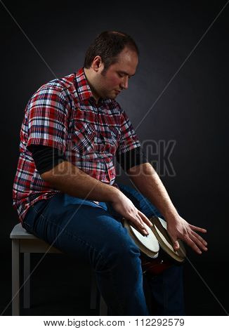 Portrait Of Musician With Bongo