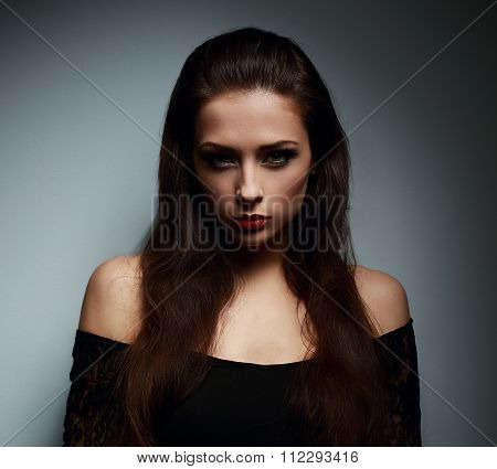 Beautiful Makeup Brunette Woman With Mystical Look On Dark Shadow Background
