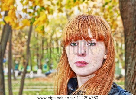 Pretty Red Hair Girl Looks At Camera.