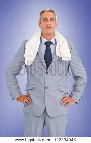 Sporty businessman with white towel against purple vignette