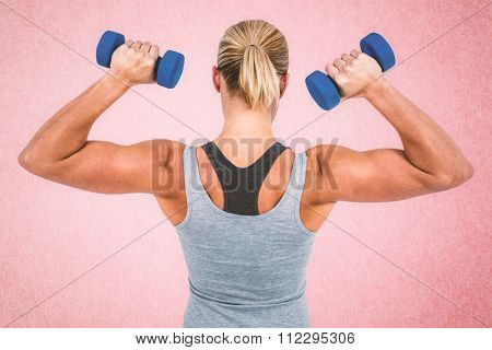 Muscular woman working out with dumbbells against pink background Muscular woman working out with dumbbells on white background