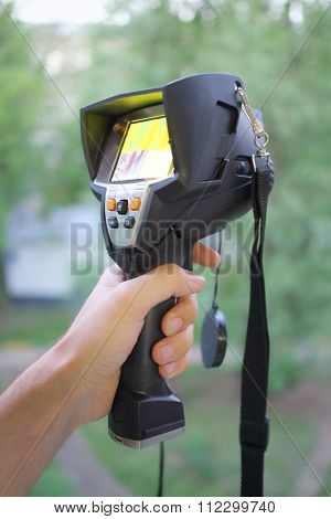 Measuring device thermal imager in a mans hand