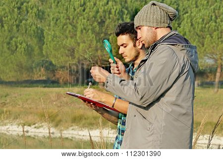 2 biologists doing botanical tests