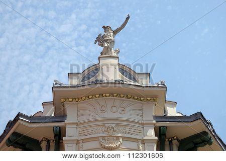 LJUBLJANA, SLOVENIA - JUNE 30: Mercury, the Roman God, at the top of the Galeria Emporium, former Mercure Center (1903), Ljubljana, Slovenia on June 30, 2015