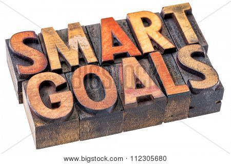 smart goals word abstract - an isolated banner in vintage letterpress wood type blocks stained by color inks -goals setting concept