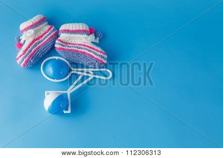 Rattles And Knitted Booties For The Newborn