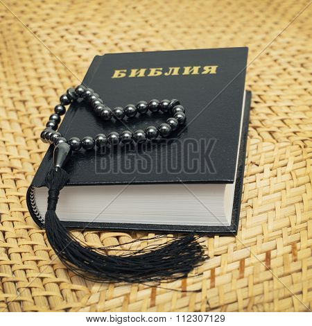 Rosary, Bible put on a straw chair