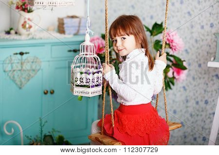Portrait Of A Cute Little Girl In The Interior With Shabby Chic Decor