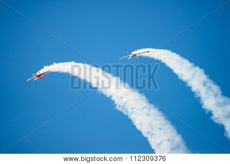 Two Stunt Planes Perform Flip